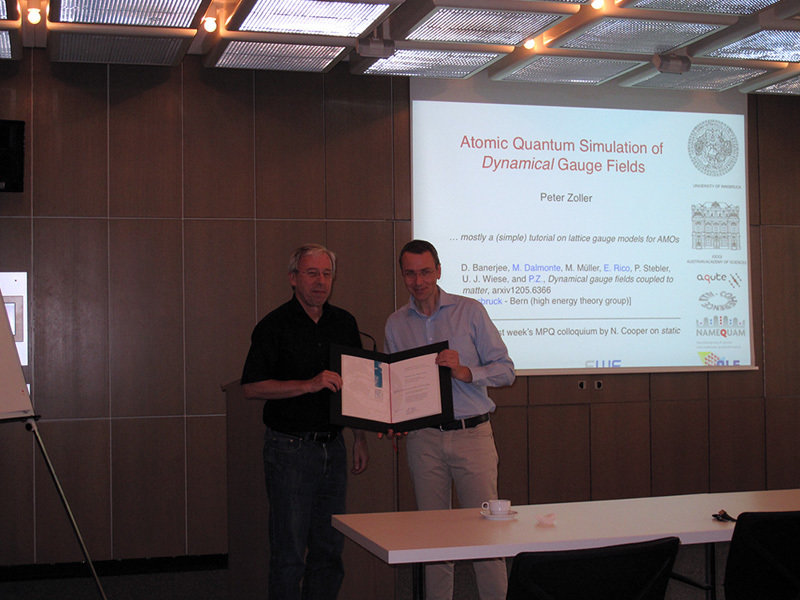 The certificate of honour was handed over to Prof. Peter Zoller (left) by the Managing Director of the MPQ, Prof. Immanuel Bloch (right) at the colloquium on July 3rd, 2012.