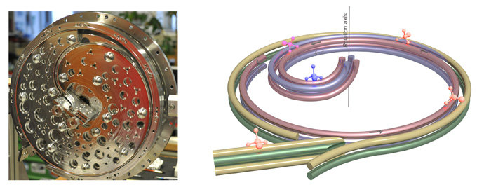 "<span style=""color: gray;""><em><strong>Fig. left:</strong> Photo of the 'centrifuge' <strong>/ Fig. right:</strong> On a fast rotating disc, an electric quadrupole guide forces the molecules to move towards the rotation axis. As the molecules have to fight against the centrifugal force on their way, they loose kinetic energy and are slowed down to almost a complete halt. <br /></em></span>"