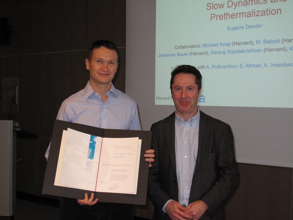 Prof. I. Cirac (right) hands the Certificate to Prof. Demler (left)